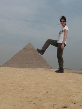 travelling in egypt with a persons foot resting on giza pyramid