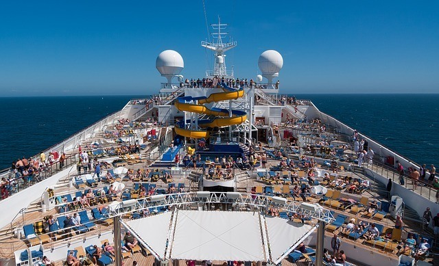 View of a ships pool with a water slide deck taken from above