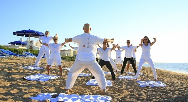 feed the soul by doing group yoga class on the beach