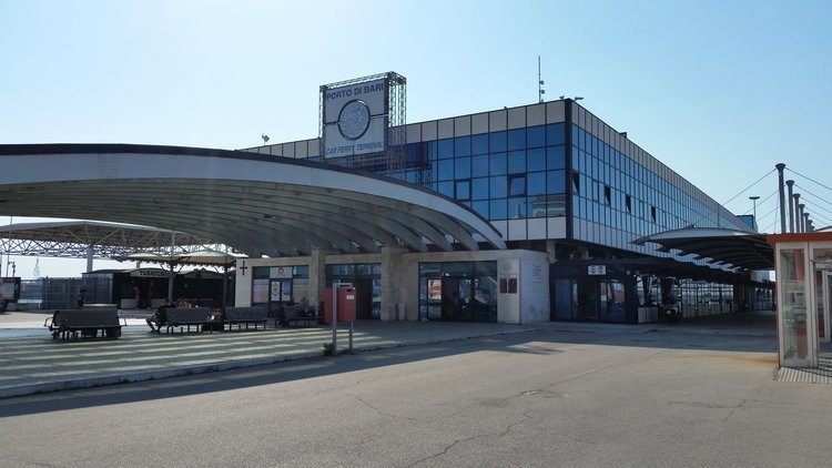 the first terminal from Bari train station, a three storey port terminal  building with a large undercover area in front.