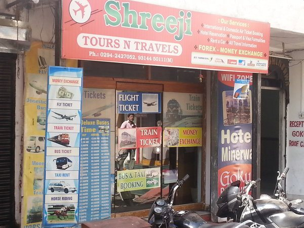 shop front image of an indian tours and travel store