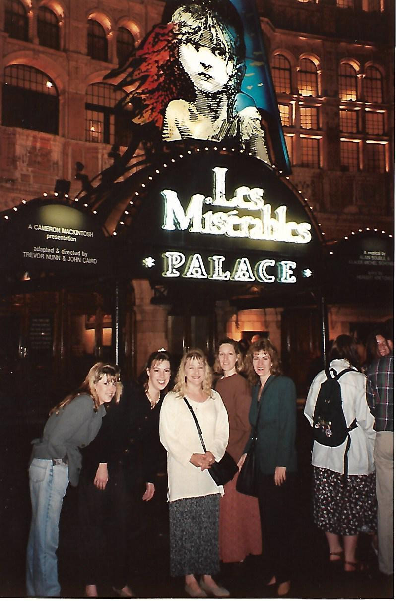 group of females standing in front of Palace Theatre in London