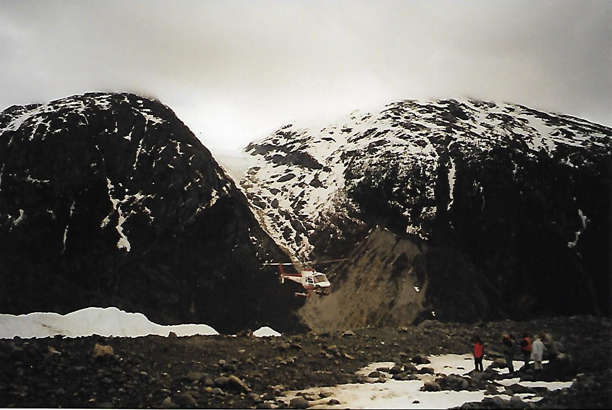 helicopter landing in a glacier valley