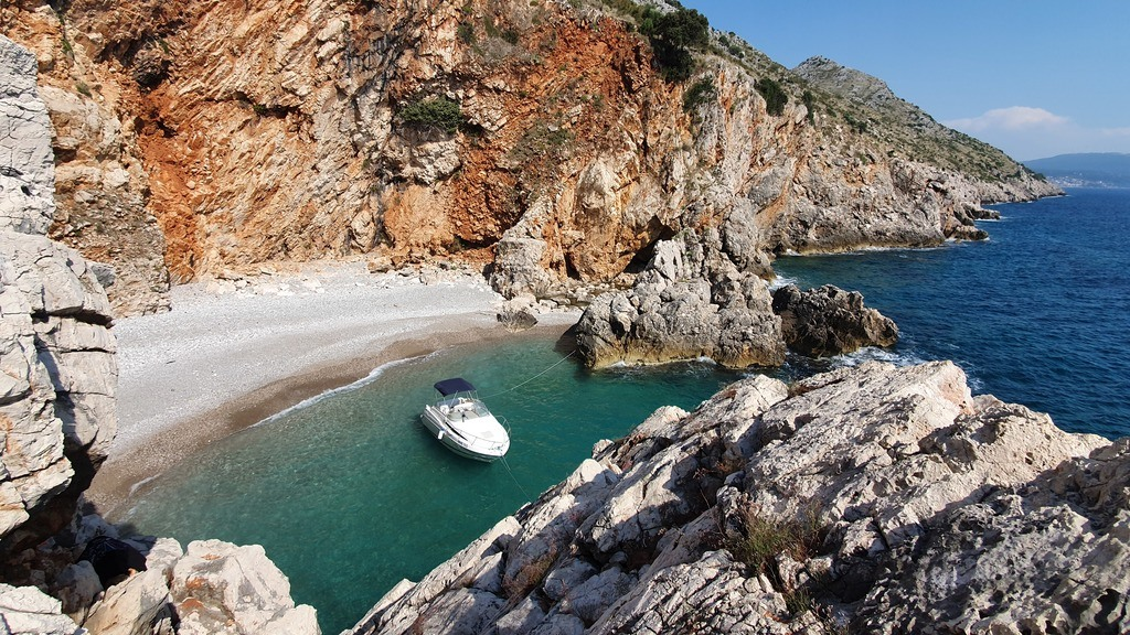 Secluded beach with a boat looking from above