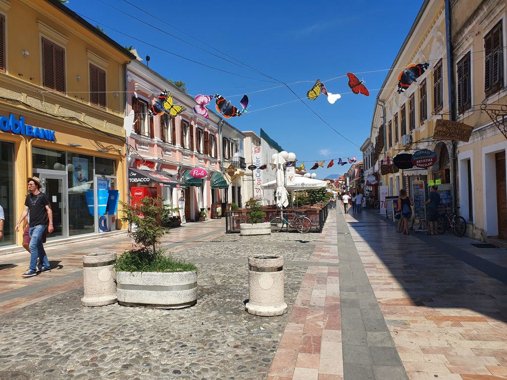 pedestrian mall street with cobblestones and colourful buildings