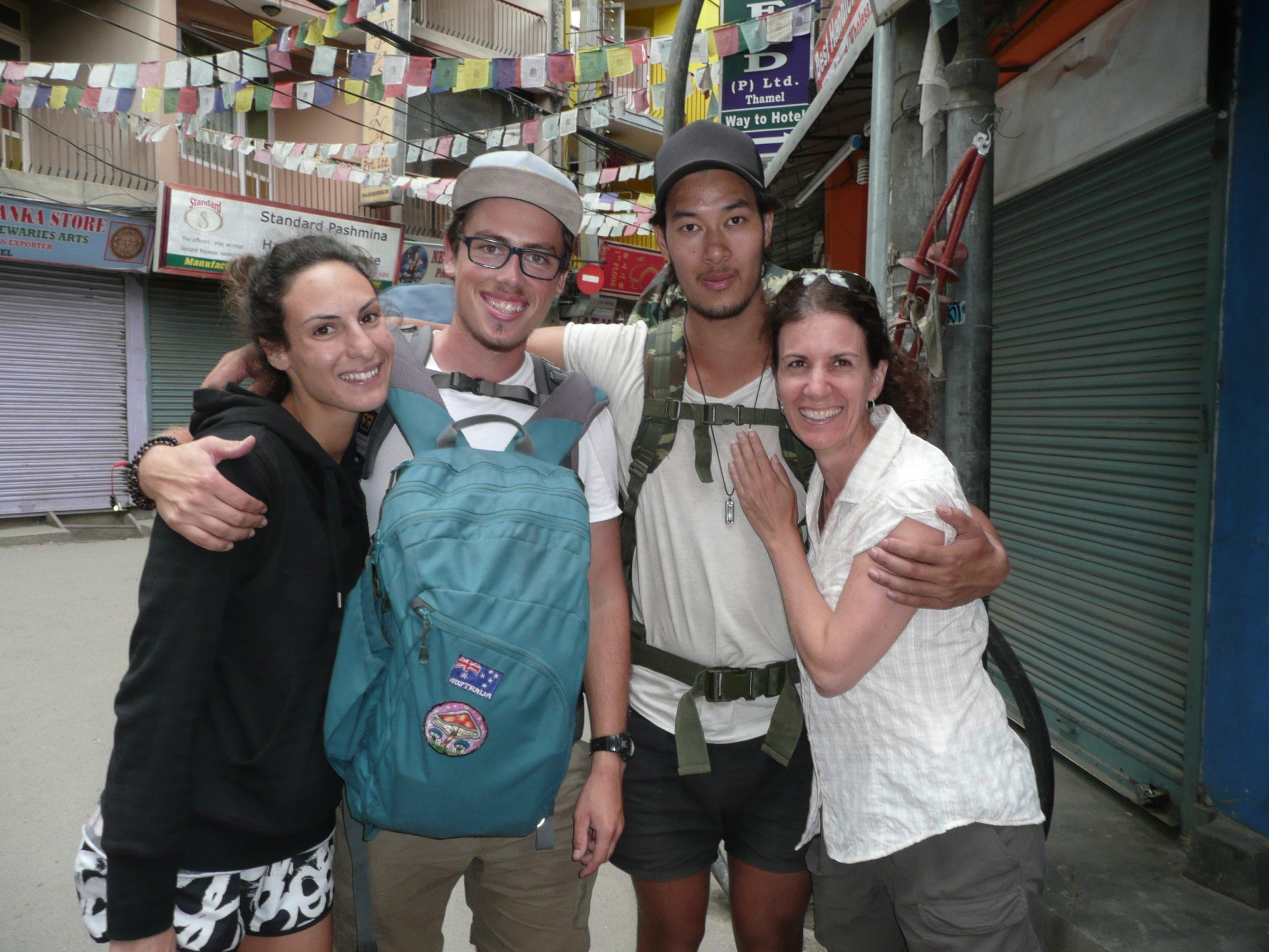 4 travellers standing on a Kathmandu street relieved to see each other