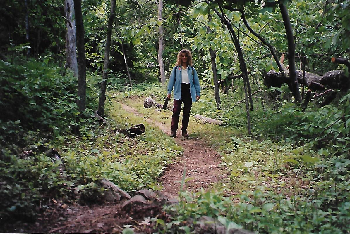 female walking along a path in a forest before the black bear encounter